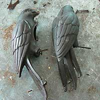 Wax molds of the parrot have just been removed from their silicone molds